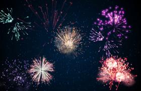 五光十色的烟火在粒子下坠的天空中绽放视频素材