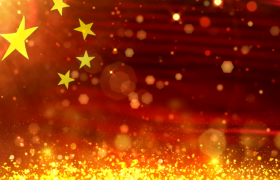 ?五星红旗迎着金色的光斑与粒子飘扬背景视频素材