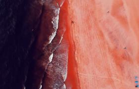 航拍奇特美麗酒紅色海灘實拍視頻素材