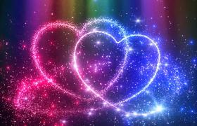炫丽多彩粒子光效汇聚成爱心婚庆表白特效视频素材
