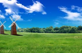 云朵藍天飄逝風車綠地上旋轉自然清新兒童視頻背景