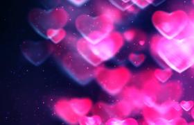 玫紅色光效愛心漂浮熒光粒子絢麗閃爍婚慶告白特效視頻素材