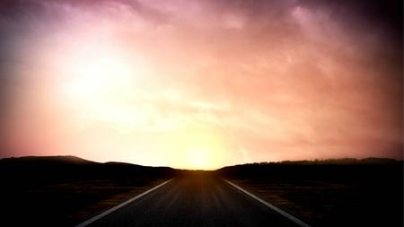 橙红色朝霞映照下的公路动态视频背景