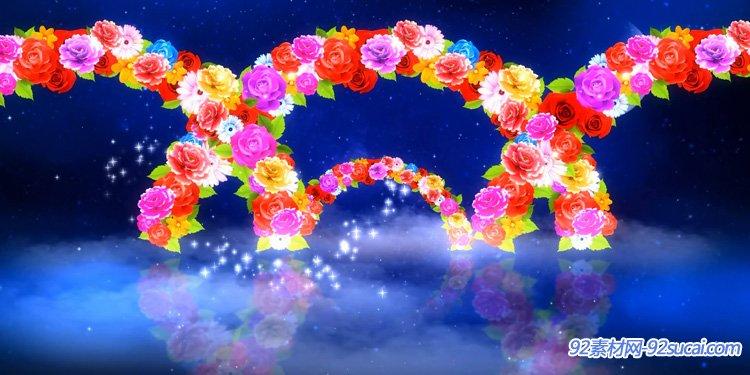 幸福的鲜花拱门 夜色星空弯月流云粒子飞翔心型浪漫婚礼配景视频