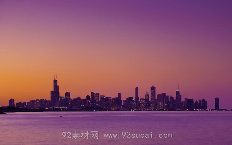 远眺城市高楼建筑 外围海域天边灯光变化高清实拍延时摄影视频素