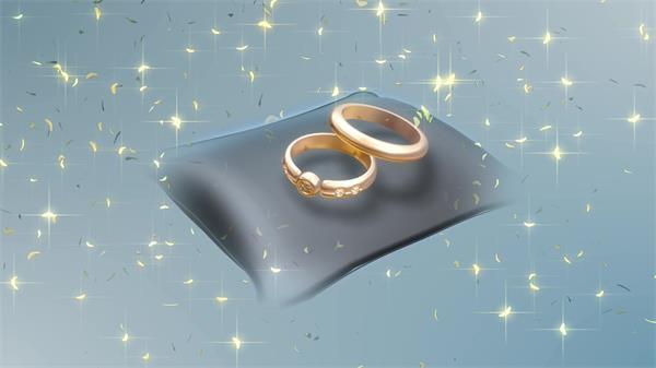 高贵豪华金色结婚戒指旋转发光叶子飘舞视频素材