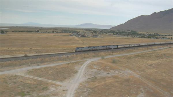 火车运输行驶在铁轨路途上郊区景色高清航拍