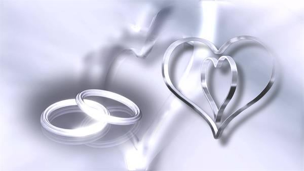 浪漫唯美白银质感圆环心形环形旋转婚礼求婚配景视频素材