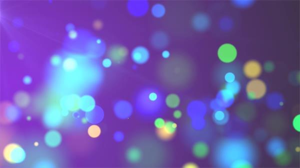 豐富多彩波點光效閃爍模糊變化粒子飄浮夢幻舞臺背景視頻素材