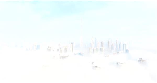 迷雾中高楼耸立云层笼罩城市建筑梦幻般城市景色高清视频实拍