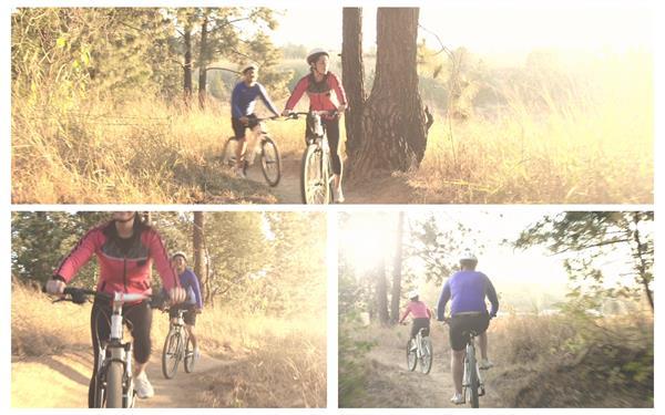 日落黄昏树林小路跟骑行爱好者林间骑自行车休闲生活高清视频实拍