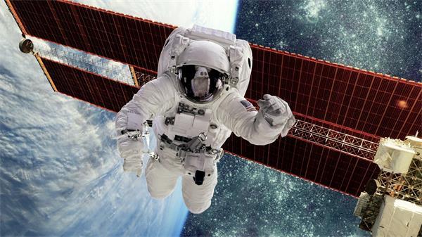 地球元素宇航员在太空之中行星粒子监测仪器镜头动态背景视频素材