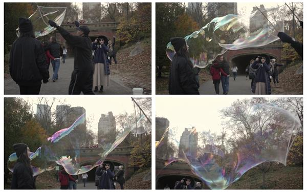 公园街道男士玩耍泡沫泡泡飘浮空中鼓起圆形气泡高清视频实拍