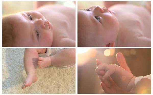 幼小可愛寶寶眼睛左右觀望雙腳動彈小手拉大手鏡頭記錄高清視頻實