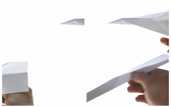 白色背景手拿折纸飞机手动飞行人物休闲娱乐活动特写高清视频实拍