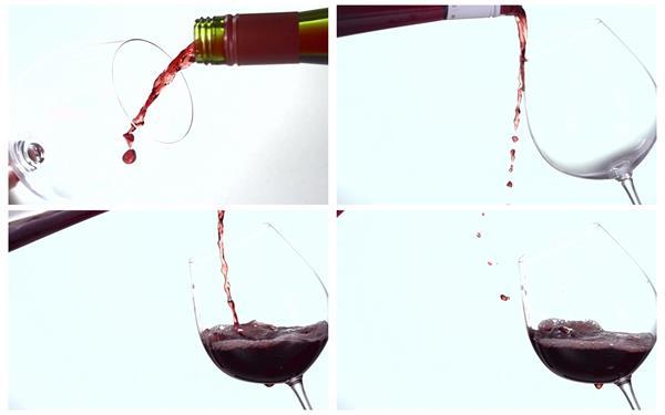 红酒倒入红羽觞里洒落玻璃杯周边慢举措镜头特写高清视频实拍